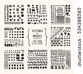 Hand drawn textures and brushes. Artistic collection of design elements: grunge lines, brush strokes, wavy lines, tribal backgrounds, geometric pattern made with ink. Isolated vector set.   Shutterstock vector #534388585