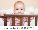 little boy chewing on her bed... | Shutterstock . vector #534397615