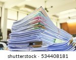 pile of documents on desk at... | Shutterstock . vector #534408181