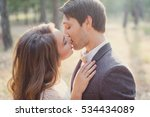 the bride and groom in a forest.... | Shutterstock . vector #534434089