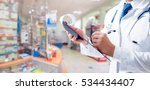 the pharmacist gives advice on... | Shutterstock . vector #534434407