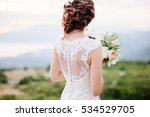 bride hold wedding bouquet of... | Shutterstock . vector #534529705