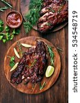 barbecue pork ribs on wooden... | Shutterstock . vector #534548719