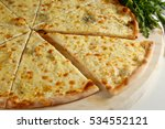 four cheese pizza on a white... | Shutterstock . vector #534552121