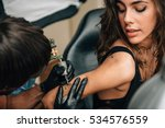 tattoo. pretty girl getting a... | Shutterstock . vector #534576559