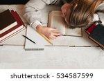 student girl sleeping on desk... | Shutterstock . vector #534587599