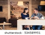 young couple talking in coffee... | Shutterstock . vector #534589951