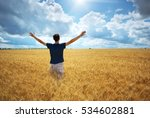 man in yellow wheat meadow.... | Shutterstock . vector #534602881