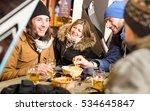 happy friends drinking beer and ...   Shutterstock . vector #534645847