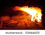 pizza baking in the old oven | Shutterstock . vector #53466655