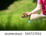 young woman meditating on mat... | Shutterstock . vector #534717031