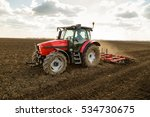 farmer in tractor preparing... | Shutterstock . vector #534730675