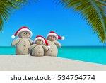 Positive Sandy Snowmen Family...
