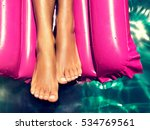 tanned well groomed feet in the ... | Shutterstock . vector #534769561