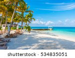 beach chairs with umbrella at... | Shutterstock . vector #534835051