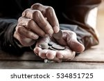 hand the old man and pile coin... | Shutterstock . vector #534851725