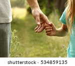 the parent holds the hand of a... | Shutterstock . vector #534859135