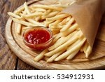 french fries wrapped in brown... | Shutterstock . vector #534912931