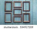 old wooden frames on old blue... | Shutterstock . vector #534917209