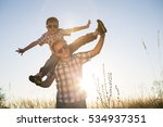 father and son playing on the... | Shutterstock . vector #534937351