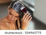 Hair Masking. Young Woman With...
