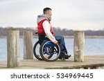 man in wheelchair enjoying his... | Shutterstock . vector #534969445
