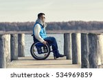 disabled young man with... | Shutterstock . vector #534969859