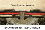 Small photo of Your Opinion Matters typed words on a vintage typewriter with vintage background