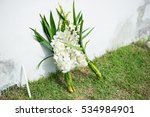 White Flower Put Between Wall...