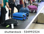 Suitcase On Luggage Conveyor...