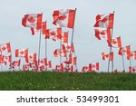 Canada maple leaf flag with blue sky background. - stock photo