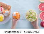 hands of a young woman holding... | Shutterstock . vector #535023961