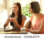 cheerful young women drinking... | Shutterstock . vector #535063579