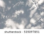 shadow of the leaves on a white ... | Shutterstock . vector #535097851