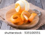 A Peeled Orange On The Wooden...