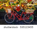 Small photo of Red old bike in market on Campo di Fiori, Rome, Italy. Rome market on Piazza Campo di Fiori is landmark of Rome.