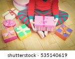 child taking christmas presents | Shutterstock . vector #535140619