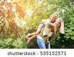 cute young daughter on a piggy... | Shutterstock . vector #535152571