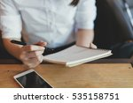 woman writing in the notebook... | Shutterstock . vector #535158751