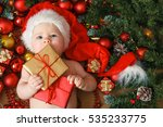 little girl in the hat of santa ... | Shutterstock . vector #535233775