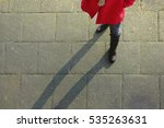 girl legs from above  red coat | Shutterstock . vector #535263631