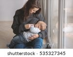 beautiful young mother... | Shutterstock . vector #535327345