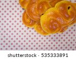 suffron buns on towel from above | Shutterstock . vector #535333891