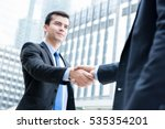 businessmen making handshake in ... | Shutterstock . vector #535354201