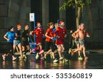 BARCELONA, SPAIN - DECEMBER 25, 2015: Christmas morning, people running with Santa Claus caps - stock photo