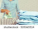 closeup of woman ironing... | Shutterstock . vector #535365514