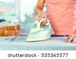 closeup of woman ironing... | Shutterstock . vector #535365577