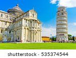 View of the Pisa Cathedral and the Leaning Tower in a sunny day in Pisa, Italy. - stock photo