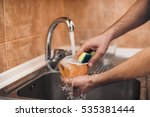 hands with sponge wash the cup... | Shutterstock . vector #535381444