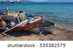 Small photo of Aigina island, traditional fishing boats in shore, Saronic gulf, Greece